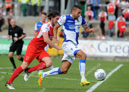 Liam Sercombe of Bristol Rovers goes past Aiden O'Neill of Fleetwood Town