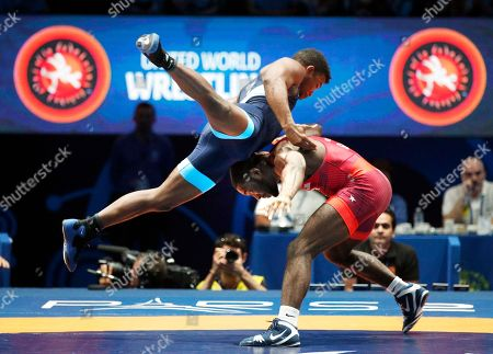 United States' James Malcom Green, right, and Frank Chamizo Marquez of Italy compete in the men's free style 70 kg category during the final of the Wrestling World Cup at the Paris Bercy Arena, in Paris, France