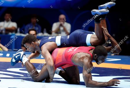 United States' James Malcom Green, and Frank Chamizo Marquez of Italy, top, compete in the men's free style 70 kg category during the final of the Wrestling World Cup at the Paris Bercy Arena, in Paris, France