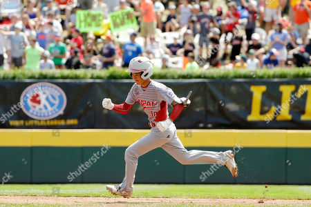 Japan's Keitaro Miyahara celebrates as he rounds the bases after hitting a solo home run off Mexico's Jorge Garcia during the first inning of the International Championship baseball game at the Little League World Series tournament, in South Williamsport, Pa. Japan won 5-0