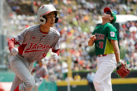 Japan's Seiya Arai, left, runs to the dugout past Mexico's Jorge Garcia after scoring on a passed ball during the first inning of the International Championship baseball game at the Little League World Series tournament, in South Williamsport, Pa. Japan won 5-0