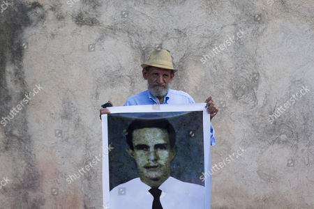 A man holds a photograph of Ramon Rodriguez Collado, arrested and disappeared in September 1959, during a march in Santo Domingo, Dominican Republic, 26 August 2017. The Memorial Museum of the Dominican Resistance remembered the disappeared victims during dictatorship of Rafael Trujillo (1930-1961) and Joaquin Balaguer (1960-1962, 1966-1978 and 1986-1996).