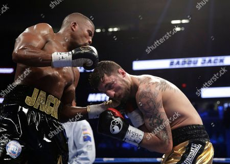 Badou Jack, left, of Sweden, hits Nathan Cleverly during a light heavyweight championship boxing match, in Las Vegas