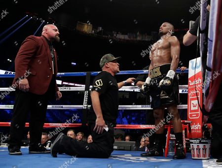 Badou Jack, of Sweden, stands in his corner between rounds in a light heavyweight championship boxing match against Nathan Cleverly, in Las Vegas