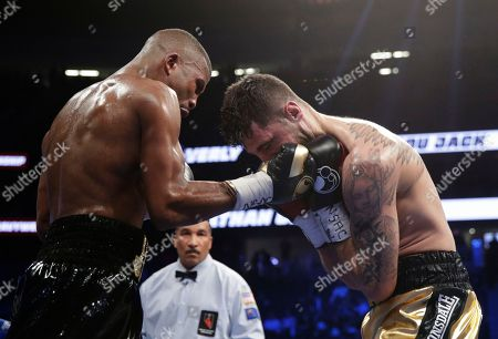Badou Jack, left, of Sweden, hits Nathan Cleverly, of Wales, during a light heavyweight championship boxing match, in Las Vegas