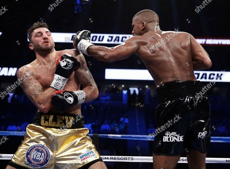 Badou Jack, right, of Sweden, fights Nathan Cleverly, of Wales, in a light heavyweight championship boxing match, in Las Vegas