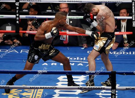 Badou Jack, left, of Sweden, hits Nathan Cleverly, of Wales, in a light heavyweight championship boxing match, in Las Vegas