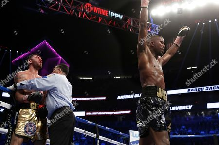 Badou Jack, right, of Sweden, celebrates after defeating Nathan Cleverly, of Wales, in a light heavyweight championship boxing match, in Las Vegas