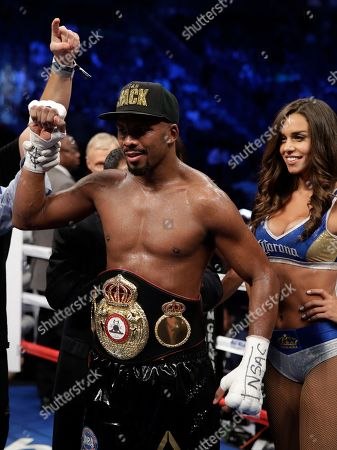 Badou Jack, of Sweden, celebrates after defeating Nathan Cleverly, of Wales, by TKO in a light heavyweight championship boxing match, in Las Vegas