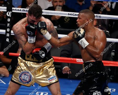 Badou Jack, of Sweden, hits Nathan Cleverly, of Wales, in a light heavyweight championship boxing match, in Las Vegas