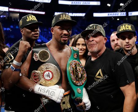 Stock Picture of Badou Jack, center, of Sweden, poses for photographers after defeating Nathan Cleverly, of Wales, by TKO in a light heavyweight championship boxing match, in Las Vegas