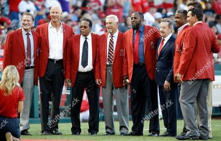Bobby Grich, Mike Witt, Rod Carew, Bobby Knoop, Vladimir Guerrero, Arte Moreno, Garret Anderson, Tim Salmon Former Los Angeles Angels players, left to right, Bobby Grich, Mike Witt, Rod Carew, Bobby Knoop, line up for a photo with Vladimir Guerrero, owner Arte Moreno, Garret Anderson, and Tim Salmon for Guerrero's induction into the Angels' Hall of Fame during a ceremony before a baseball game against the Houston Astros in Anaheim, Calif