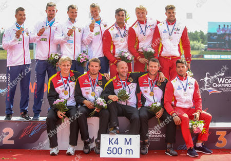 Second placed Carlos Garrote, Cristian Toro, Marcus Cooper Walz and Rodrigo Germade of Spain (R), first placed Max Rendschmidt, Ronald Rauhe, Tom Liebscher and Max Lemke of Germany (down) and third placed Jakub Spicar, Daniel Havel, Jan Sterba and Radek Slouf of Czech Republic (L) pose on the podium during medal ceremony for Men's K4 500m race of the ICF Canoe Sprint World Championships in Racice, Czech Republic, 27 August 2017.