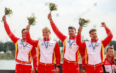 Second placed Carlos Garrote, Cristian Toro, Marcus Cooper Walz and Rodrigo Germade of Spain celebrate on the podium during medal ceremony for Men's K4 500m race of the ICF Canoe Sprint World Championships in Racice, Czech Republic, 27 August 2017.