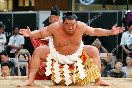 Sumo wrestler Harumafuji Kohei performs during a special Grand Sumo Tournament held in the KITTE commercial complex located in front of Tokyo Station, Tokyo, Japan.