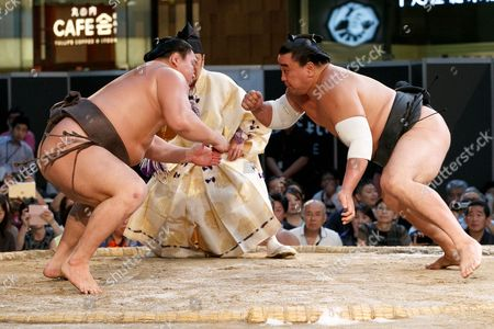 Stock Photo of (L to R) Sumo wrestlers Hakuho Sho and Harumafuji Kohei participate in a special Grand Sumo Tournament held in the KITTE commercial complex located in front of Tokyo Station, Tokyo, Japan.