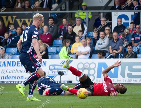 Alfredo Morelos of Rangers challenged inside the penalty box by Jason Naismith of Ross County. Referee Craig Thomson waved play on.