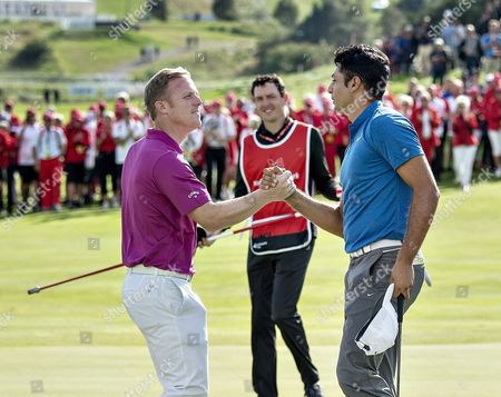 Julian Suri (R) of the USA  is congratulated by David Horsey of England after winning the Made in Denmark golf tournament at the Himmerland Golf & Spa Resort, in Julian Suri of the USA celebrates his, Denmark, 27 August 2017.