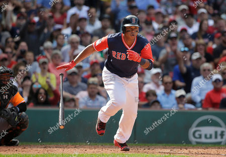 Welington Castillo, Rafael Devers Boston Red Sox's Rafael Devers, right, runs after hitting an RBI double off a pitch by Baltimore Orioles' Mychal Givens as Orioles' Welington Castillo, left, looks on in the sixth inning of a baseball game, in Boston