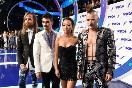 Jack Lawless, from left, Joe Jonas, JinJoo Lee, and Cole Whittle of DNCE arrive at the MTV Video Music Awards at The Forum, in Inglewood, Calif