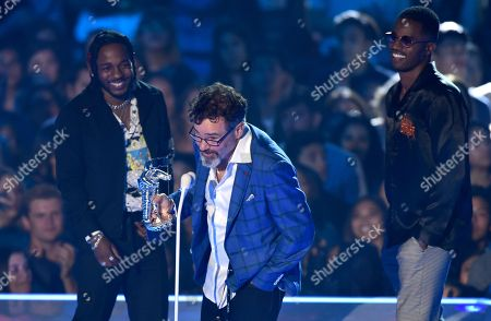"Dave Meyers, Kendrick Lamar, Dave Free Dave Meyers, center, and from left, Kendrick Lamar and Dave Free accepts the award for best hip hop video for ""HUMBLE."" at the MTV Video Music Awards at The Forum, in Inglewood, Calif"