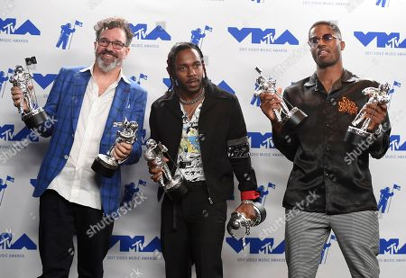"Dave Meyers, Kendrick Lamar, Dave Free Dave Meyers, from left, Kendrick Lamar, and Dave Free pose in the press room with the awards for best direction, best cinematography, best art direction, best visual effects, best hip hop video and video of the year for ""HUMBLE."" at the MTV Video Music Awards at The Forum, in Inglewood, Calif"