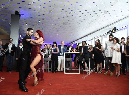 Alan Bersten, Sharna Burgess Alan Bersten, left, and Sharna Burgess perform at the Choreography Nominee Reception at the Television Academy's Saban Media Center, in the NoHo Arts District in Los Angeles