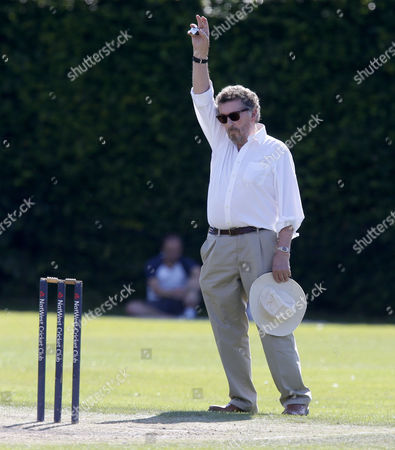 Actor Robert Powell Umpires the game