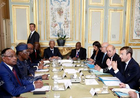 French President Emmanuel Macron, right, meets the President of Niger Mahamadou Issoufou, left, and Chad President Idriss Deby Itno, second left, at the Elysee Palace in Paris, Monday, Aug.28, 2017. The leaders of France, Germany, Italy and Spain are meeting Monday with counterparts from Libya, Niger and Chad to discuss ways to curb illegal migration across the Mediterranean Sea to European shores