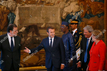 From left to right : Spain's Prime Minister Mariano Rajoy, France's President Emmanuel Macron, Chad's President Idriss Deby Itno, German Chancellor Angela Merkel and Italian premier Paolo Gentiloni arrive to attend a joint press conference after their meeting at the Elysee Palace, in Paris, France, . The leaders of France, Germany, Italy and Spain are meeting with African counterparts to find ways to curb illegal migration across the Mediterranean to European shores