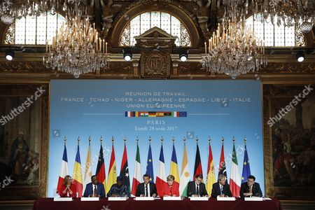 (L-R) EU High Representative for Foreign Affairs and Security Policy Federica Mogherini, Niger's President Mahamadou Issoufou, Chad's President Idriss Deby Itno, French President Emmanuel Macron, German Chancellor Angela Merkel, Spanish Prime Minister Mariano Rajoy, Italian Prime Minister Paolo Gentiloni and Libyan Prime Minister Fayez al-Sarraj attend a press conference at the Elysee Palace in Paris, France, 28 August 2017. Leaders from Germany, Spain, Italy and the EU meet with their counterparts from Niger, Chad and Libya in Paris for discussions on how to stem economic migration. The meeting is organized by French President Macron.