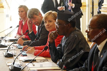 German Chancellor Angela Merkel (C), Chadian President Idriss Deby Itno (2-R) and EU Foreign Policy Chief Federica Mogherini (L) sit for a meeting at the Elysee Palace in Paris, France, 28 August 2017. Leaders from Germany, Spain, Italy and the EU meet with their counterparts from Niger, Chad and Libya in Paris for discussions on how to stem economic migration. The meeting is organized by French President Macron.