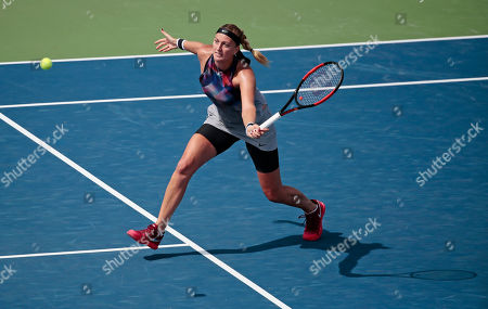 Petra Kvitova, of Czech Republic, returns a shot from Jelena Jankovic, of Serbia, during the first round of the U.S. Open tennis tournament, in New York