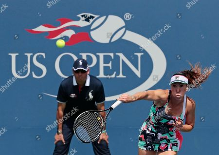 Jelena Jankovic, of Serbia, serves to Petra Kvitova, of Czech Republic, during the first round of the U.S. Open tennis tournament, in New York