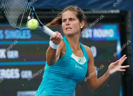 Julia Goerges, of Germany, returns a shot from Annika Beck, of Germany, during the first round of the U.S. Open tennis tournament, in New York