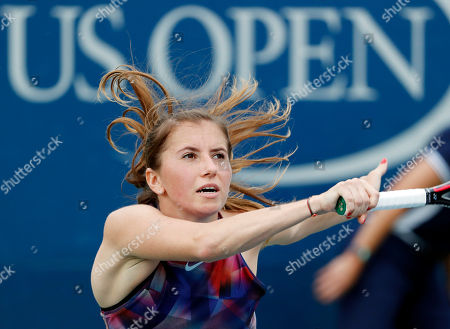 Stock Picture of Annika Beck, of Germany, returns a shot from Julia Goerges, of Germany, during the first round of the U.S. Open tennis tournament, in New York