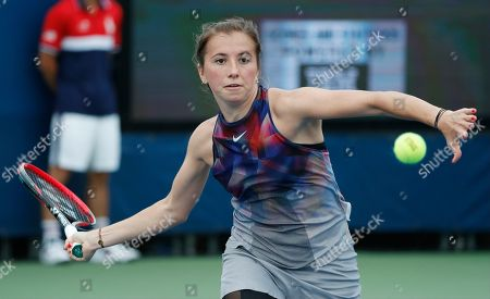 Annika Beck, of Germany, returns a shot from Julia Goerges, of Germany, during the first round of the U.S. Open tennis tournament, in New York