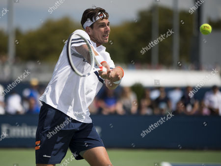 Cameron Norrie of Great Britain in action against Dmitry Tursunov of Russia in the first round of the US Open