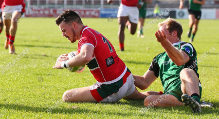 Cavan Boyer of Plymouth Albion goes over for a try as he is tackled by Ben Watts of IvyBridge RFC during the Pre Season match between Plymouth Albion v Ivybridge RFC at the Brickfields Recreation Ground, on August 28th 2017, Plymouth, Devon, UK.