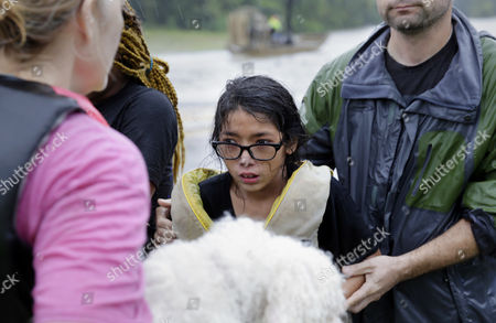 Lanie Gould, age 11, reacts after being helped back onto dry land after being rescued from their home along Cypress Creek at Kuykendal 15 miles northwest of downtown Houston, Texas, USA, 28 August 2017. The areas in and around Houston and south Texas are experiencing record floods after more than 24 inches of rain after Harvey made landfall in the south coast of Texas as a category 4 hurricane, the most powerful to affect the US since 2004. Harvey has weakened and been downgraded to a tropical storm and is expected to cause heavy rain for several days.