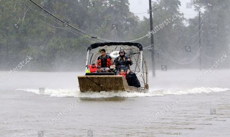 A boat ferries rescued residents from homes and apartments across the flooded area of Cypress Creek at Kuykendal 15 miles northwest of downtown Houston, Texas, USA, 28 August 2017. The areas in and around Houston and south Texas are experiencing record floods after more than 24 inches of rain after Harvey made landfall in the south coast of Texas as a category 4 hurricane, the most powerful to affect the US since 2004. Harvey has weakened and been downgraded to a tropical storm and is expected to cause heavy rain for several days.