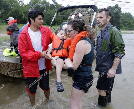 Mindy Walker and her three year old son Connor Martinez are helped out of a boat after being rescued from their home along Cypress Creek at Kuykendal 15 miles northwest of downtown Houston, Texas, USA, 28 August 2017. The areas in and around Houston and south Texas are experiencing record floods after more than 24 inches of rain after Harvey made landfall in the south coast of Texas as a category 4 hurricane, the most powerful to affect the US since 2004. Harvey has weakened and been downgraded to a tropical storm and is expected to cause heavy rain for several days.