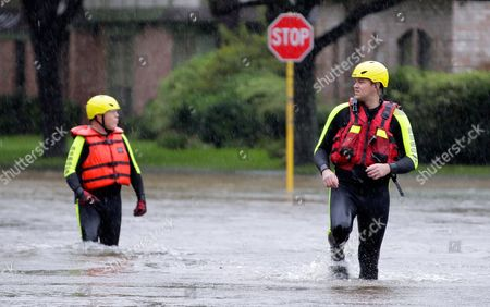 Klein volunteer fire fighters Fran Orlandino and Josh Wilson wade through flooded streets as they look for stranded residents in Klein, a north suburb of Houston, Texas, USA, 28 August 2017. The areas in and around Houston and south Texas are experiencing record floods after more than 24 inches of rain after Harvey made landfall in the south coast of Texas as a category 4 hurricane, the most powerful to affect the US since 2004. Harvey has weakened and been downgraded to a tropical storm and is expected to cause heavy rain for several days.