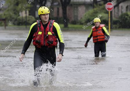 Klein volunteer fire fighters Josh Wilson and Fran Orlandino wade through flooded streets as they look for stranded residents in Klein, a north suburb of Houston, Texas, USA, 28 August 2017. The areas in and around Houston and south Texas are experiencing record floods after more than 24 inches of rain after Harvey made landfall in the south coast of Texas as a category 4 hurricane, the most powerful to affect the US since 2004. Harvey has weakened and been downgraded to a tropical storm and is expected to cause heavy rain for several days.