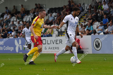Shaun Jeffers of Boreham Wood holds off Paul Rutherford of Wrexham during the Vanarama National League match between Boreham Wood and Wrexham at Meadow Park, Boredom Wood, Hertfordshire on August 28.