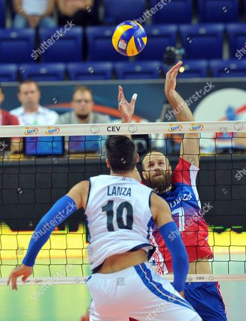 Ales Holubec (R) of Czech Republic and Filippo Lanza (L) of Italy in action during the 2017 CEV Volleyball European Championship group B match between Czech Republic and Italy in Szczecin, Poland, 28 August 2017.