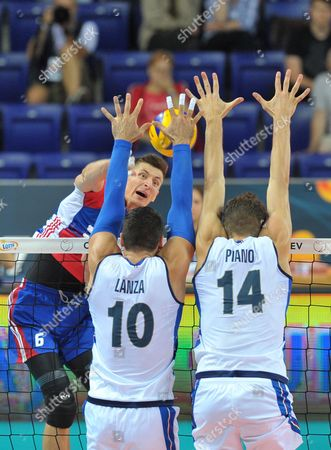Michal Finger (L) of Czech Republic and Filippo Lanza (C) with Matteo Piano of Italy in action during the 2017 CEV Volleyball European Championship group B match between Czech Republic and Italy in Szczecin, Poland, 28 August 2017.