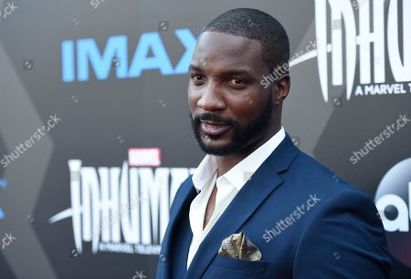 Eme Ikwuakor arrives at the world premiere of 'Inhumans' at Universal CityWalk, in Universal City, Calif