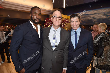 Eme Ikwuakor, Greg Foster, Imax Entertainment CEO, and Anson Mount