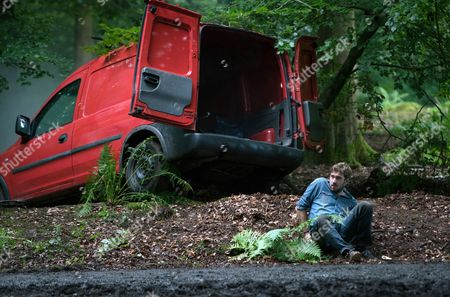 Ep 9246 Monday 11th September 2017 - 1st Ep Having told Eileen he has a job in Scotland Phelan, as played by Connor McIntyre, ties a terrified Andy's, as played by Oliver Farnworth, wrists and bundles him in the back of his van telling him they are leaving for France with his fake passport. When the van crashes in the woods Andy kicks open the doors and discovering Phelan unconscious at the wheel makes a run for it.
